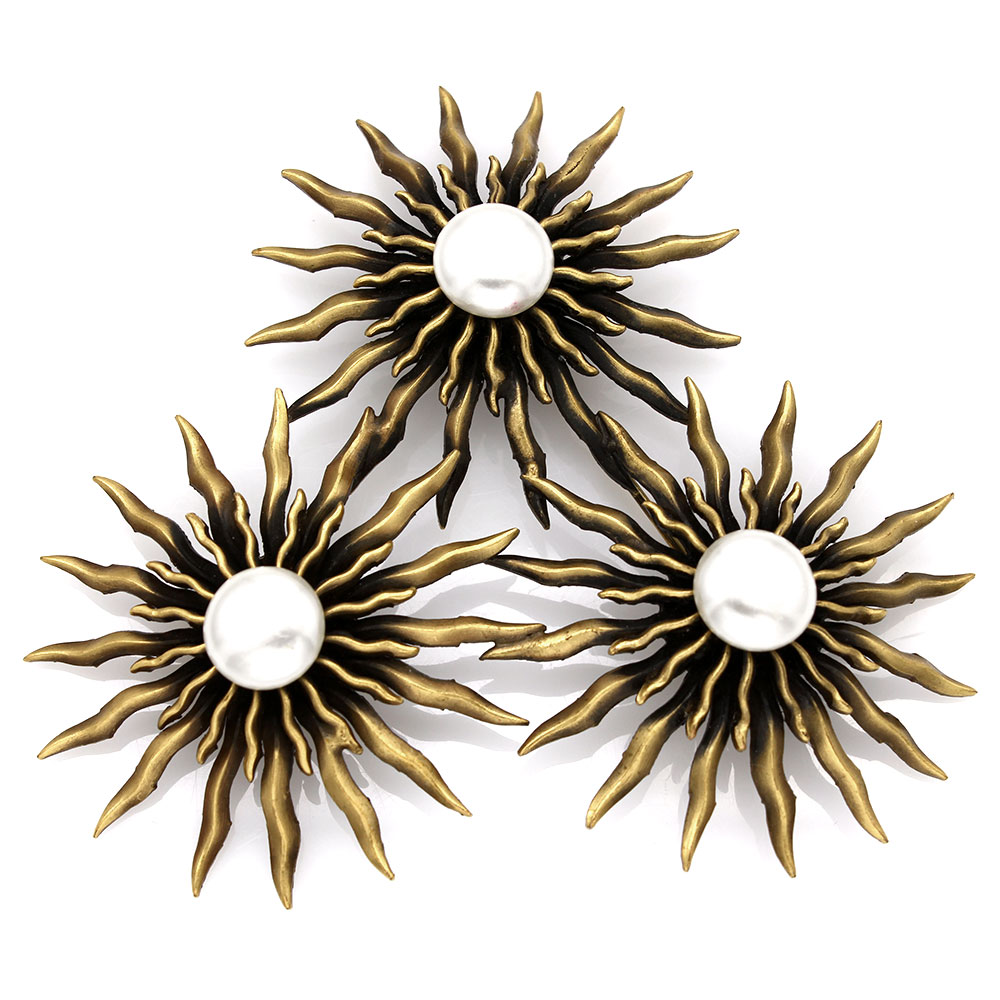 Joseff Sunburst Brooch in Metal