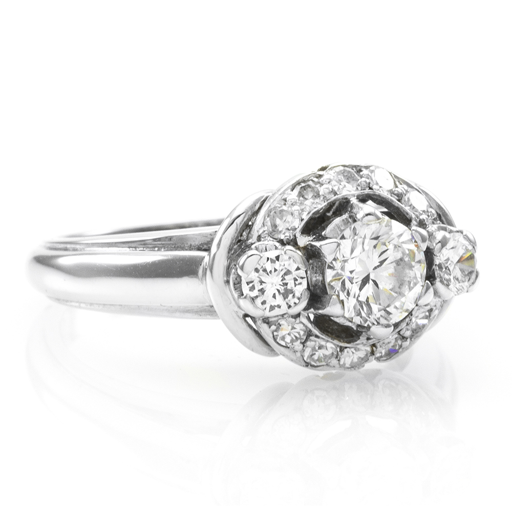 Three Stone Diamond Ring with Halo in Gold